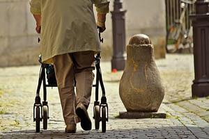 man walking with a walking aid