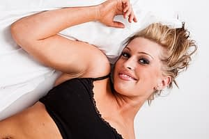 woman smiling on bed 2