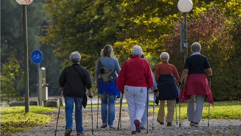 women walking with aids